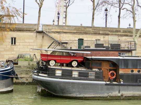Cool little vehicle on Seine barge