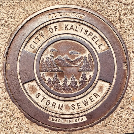 Even the storm sewer covers are beautiful in Montana